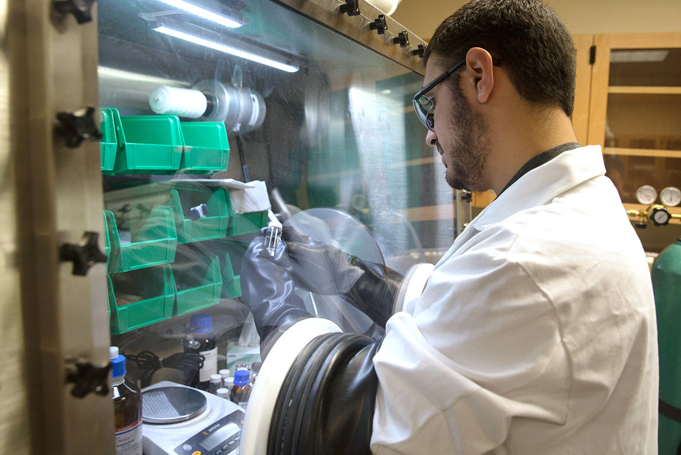 Male student works in a chemistry lab